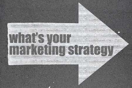 Arrow on asphalt road written word whats your marketing strategy .