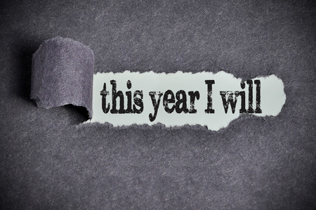 this year I will word under torn black sugar paper. Stock Photo