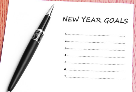 Pen  and notes paper with new year goals. Stock Photo