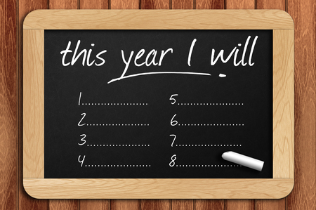 new years resolutions: Chalkboard on the wooden table written this year I will. Stock Photo