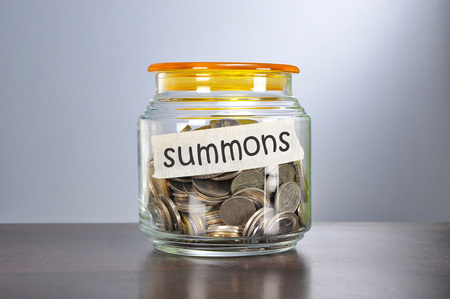 summons: Saving concept of coins in the glass jar for summons  purpose.