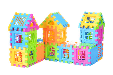 Multi color building pieces block create house isolated on white background.