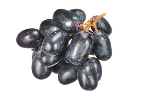 seedless: Delicious and fresh black seedless grape isolated on white.