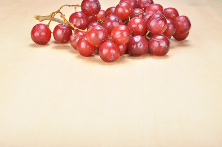 seedless: Delicious bunch red seedless crimson grape on wood plank.