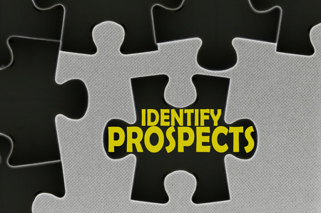 prospecting: The white jigsaw puzzle written word identify prospects.