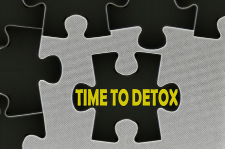 renewing: The white jigsaw puzzle written word time to detox. Stock Photo