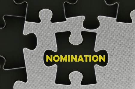 nomination: The white jigsaw puzzle written word  nomination Stock Photo