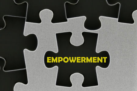 black empowerment: The black jigsaw puzzle written word empowerment. Stock Photo