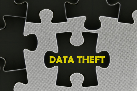data theft: The black jigsaw puzzle written word data theft.