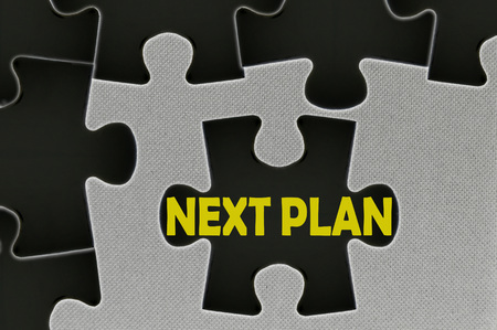 move ahead: The white jigsaw puzzle written word next plan.