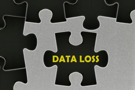 data loss: The black jigsaw puzzle written word  data loss. Stock Photo