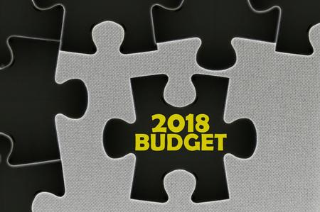 stimulus: The black jigsaw puzzle written word 2018 budget.