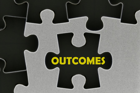 outcomes: The white jigsaw puzzle written word  outcomes Stock Photo