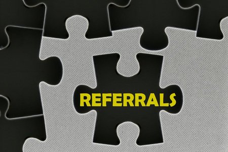 referrals: The white jigsaw puzzle written word  referrals