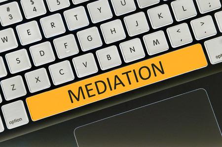 mediate: Keyboard space bar button written word mediation .