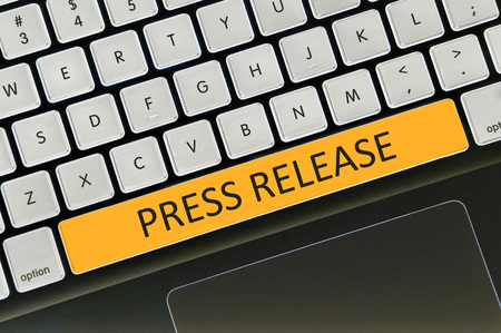 The computer keyboard button written word press release .