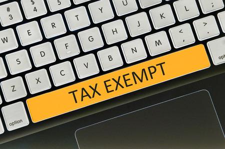 exempt: The computer keyboard button written word tax exempt .