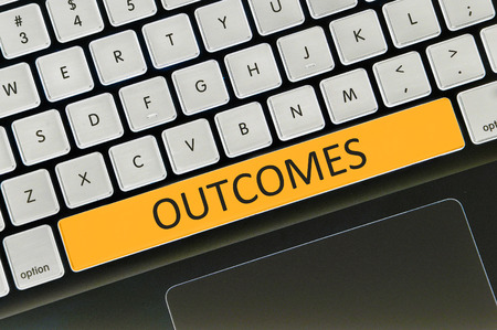 outcomes: Keyboard space bar button written word outcomes . Stock Photo