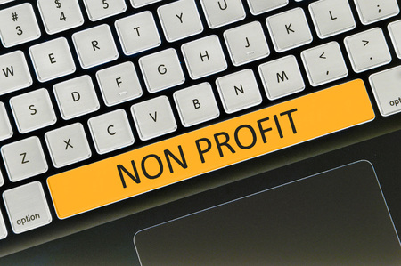 non profit: Keyboard space bar button written word non profit . Stock Photo