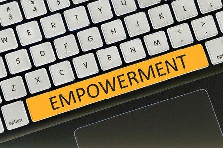 empowered: The computer keyboard button written word empowerment . Stock Photo