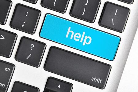 The computer keyboard button written word help. Archivio Fotografico