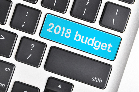 The computer keyboard button written word  2018 budget.