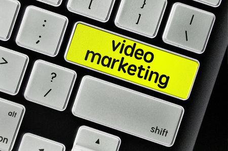 The computer keyboard button written word video marketing .