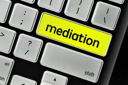 mediation: The computer keyboard button written word mediation . Stock Photo