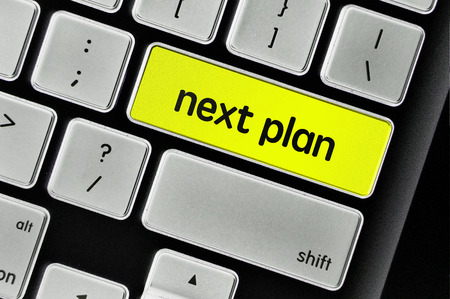 what's ahead: The computer keyboard button written word next plan . Stock Photo