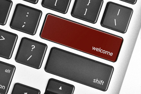 sentiment: The computer keyboard button written word welcome .