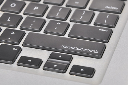 eradicate: The computer keyboard button written word rheumatoid arthritis .