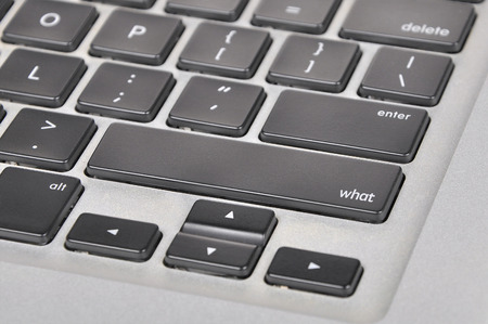 querying: The computer keyboard button written word what. Stock Photo