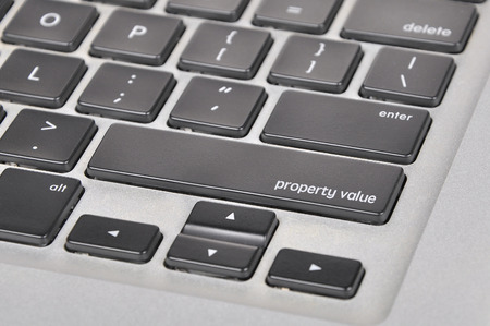 information age: The computer keyboard button written word property value . Stock Photo