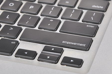 leadership potential: The computer keyboard button written word empowerment . Stock Photo