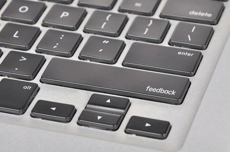 criticize: The computer keyboard button written word feedback.