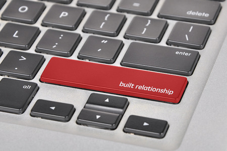 trustful: The computer keyboard button written word built relationship .