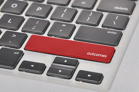 outcomes: The computer keyboard button written word outcomes . Stock Photo