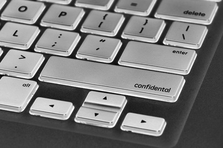 covert: The computer keyboard button written word confidental . Stock Photo