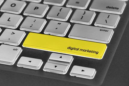 computer button: The computer keyboard button written word  digital marketing. Stock Photo