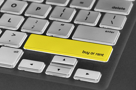 personal decisions: The computer keyboard button written word buy or rent . Stock Photo
