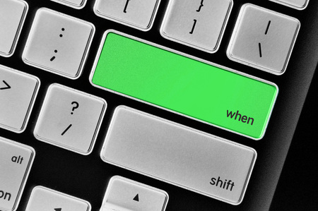 inquiring: The computer keyboard button written word when. Stock Photo