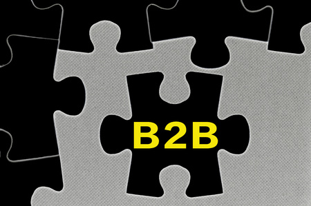 The black jigsaw puzzle written word business to business ( B2B ) marketing.