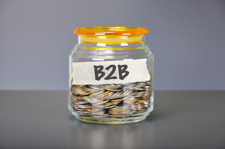 Saving concept of coins in the glass jar for business to business ( B2B ) marketing Archivio Fotografico