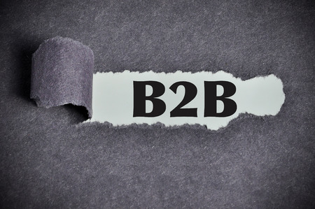 Business to business (B2B) word under torn black sugar paper.