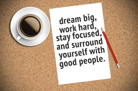 big cork: Inspirational motivating quote on paper with coffee, pencil and cork background. Dream big, work hard, stay focused, and surround yourself with good people.