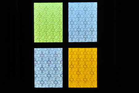 traditional window of malay house illuminate by the bright sun outside the house..