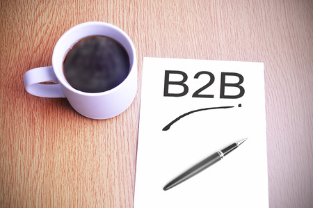Coffee on the table with note writing Business to business (B2B)