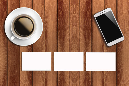 Top view flat lay blank business card, coffee and smart phone with copyspace area.