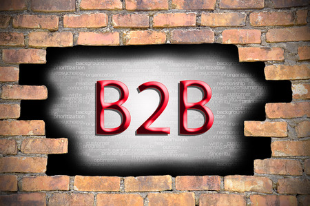 Business to business (B2B) in the hole of brick wall.