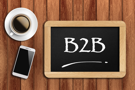 coffee, phone and chalkboard with Business to business (B2B)